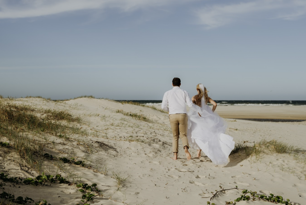 Byron Bay wedding photography bride and groom walking along the beach