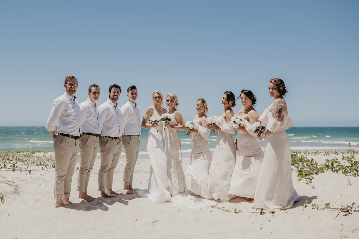 Same sex bridal party at the beach