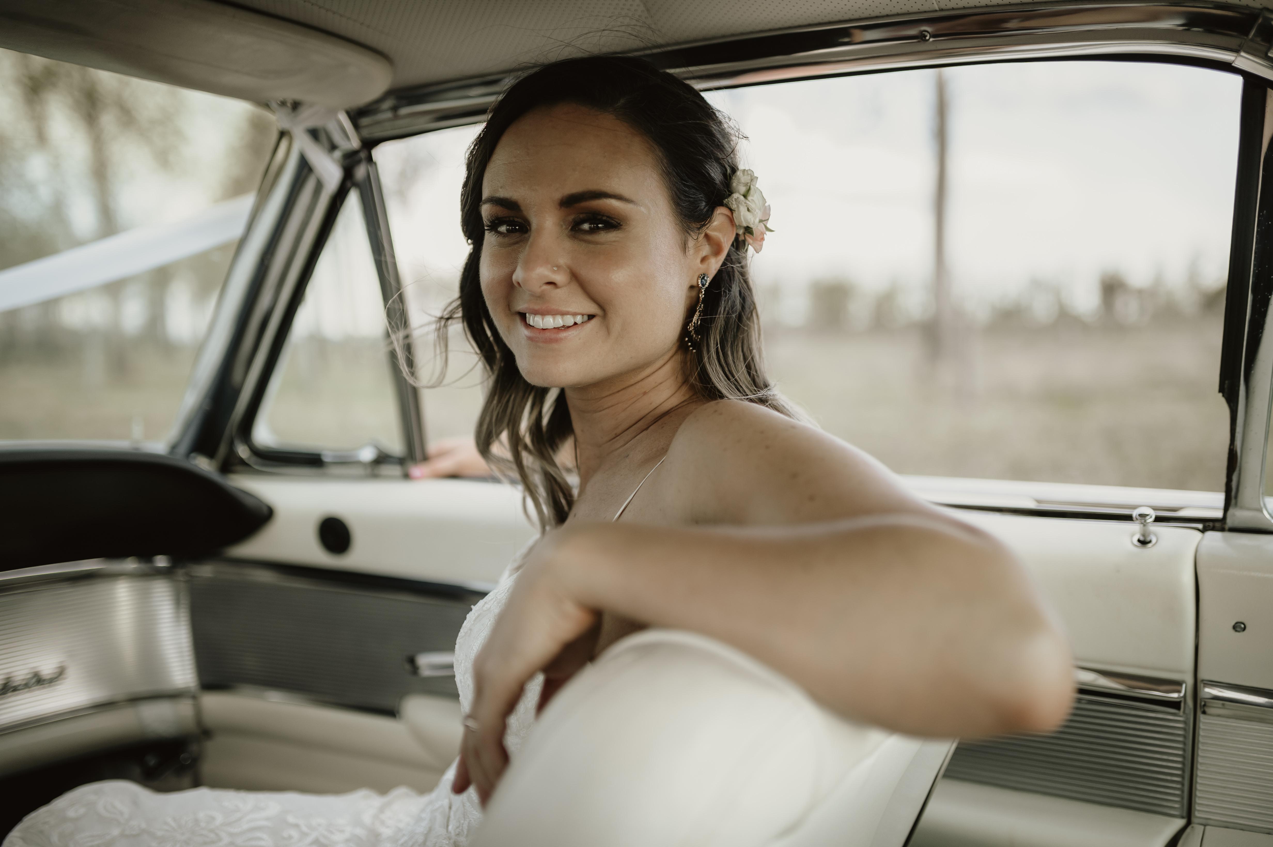 Bride sitting in classic car